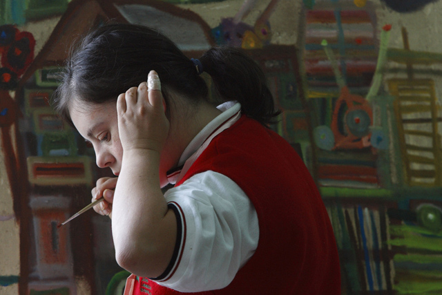 **APN ADVANCE FOR FEB. 10** Maria Soto paints in a studio at the Mexican School of Down Art in Mexico City, Friday, Oct. 19, 2007. The Mexican School of Down Art, where all the students have Down syndrome, is working to abolish preconceptions about what mentally disabled people are capable of, particularly in the developing world where resources for the handicapped are scarce and many struggle to be treated with dignity.