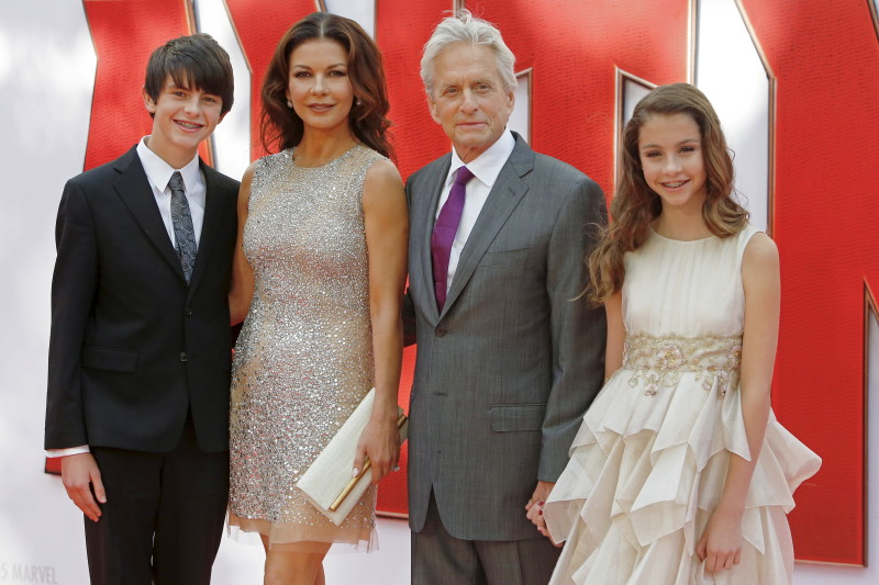"""Husband and wife actors Catherine Zeta-Jones and Michael Douglas arrive with children Dylan and Carys for the European premiere of """"Ant-Man"""" at Leicester Square in London, Britain July 8, 2015. REUTERS/Luke MacGregor - RTX1JME6"""
