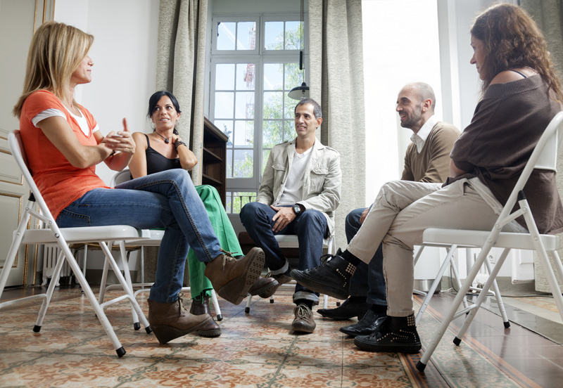 Group therapy meeting. Two males and three women talking in the psi gabinet.