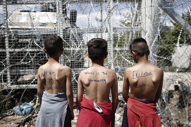 epa05290755 Refugee boys take part in a protest demanding the opening of the border between Greece and Former Yugoslav Republic of Macedonia (FYROM) at a refugee camp, near the village of Idomeni, northern Greece, 05 May 2016. Approximately 80 refugees are protesting on Thursday at the Greece-FYROM buffer zone asking for the borders to open in order to continue their trip to northern Europe. The government will soon take the necessary measures to normalize rail freight traffic in Greece and address the problems that have arisen with the blockade of the railway line in Idomeni, Government Vice President Yiannis Dragasakis said, in a meeting on 05 May 2016. EPA/KOSTAS TSIRONIS