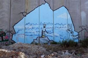 Banksys Kunst auf der Sperrmauer in der Westbank.
