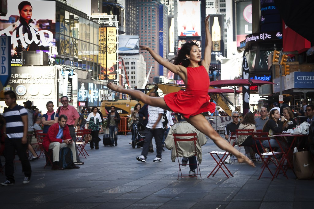 """A dancer poses for a photograph as part of the """"Dance as Art"""" photo project in Times Square in New York"""