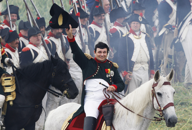 History enthusiasts fight during a re-enactment of Napoleon's famous battle of Waterloo in Braine-l'Alleud