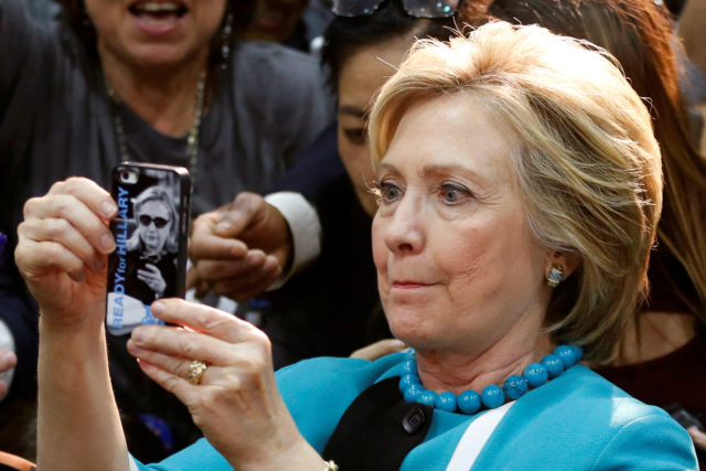 Democratic presidential candidate Hillary Clinton takes a selfie after speaking at East Los Angeles College in Los Angeles, California, U.S., May 5, 2016. REUTERS/Lucy Nicholson - RTX2D1N0