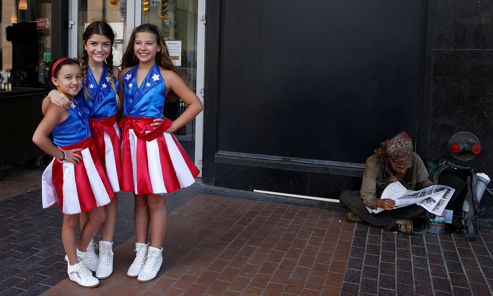 Alexis Popick (L), 9, Blanca Lombardo (C) ,11, and Melaina Buhler, 11, of USA Freedom Kids, pose near the site of the Republican National Convention in Cleveland, Ohio, U.S. July 20, 2016. REUTERS/Shannon Stapleton - RTSIXVQ