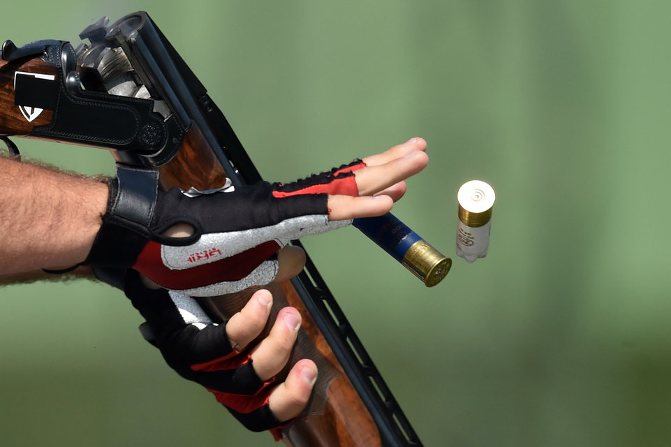 Italy's Davide Gasparini competes in the men's double trap qualification at the 2015 European Games in Baku on June 19, 2015. AFP PHOTO / KIRILL KUDRYAVTSEV