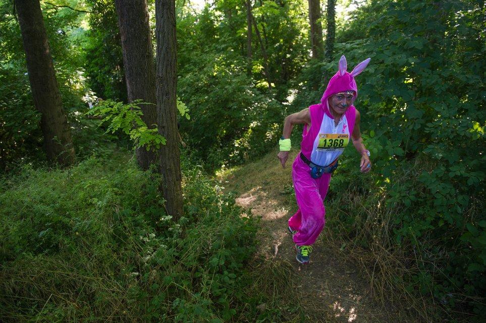 A woman dressed in a rabbit outfit takes part in a 26 Km trail run, the 5th Trail du Kochersberg, on June 13, 2015 in Quatzenheim, eastern France's Alsace region. AFP PHOTO / SEBASTIEN BOZON