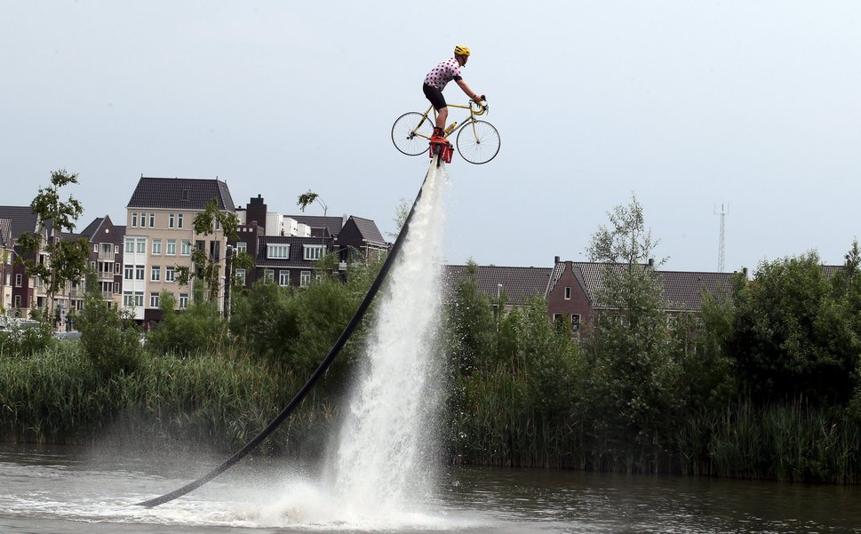 A man wearing a Tour de France best climber's jersey practises flyboarding before the start of the 166-km (103.15 miles) second stage of the 102nd Tour de France cycling race from Utrecht to Zeeland July 5, 2015. REUTERS/Stefano Rellandini
