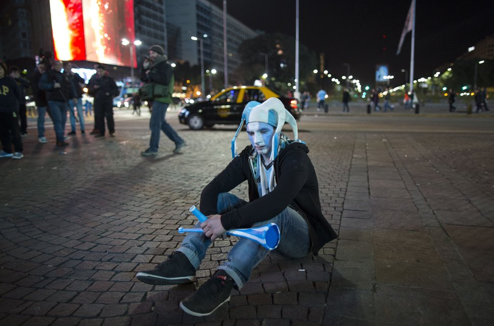 An Argentina soccer fan sits on the sidewalk after watching his team loose the final Copa America match to Chile, in downtown Buenos Aires, Argentina, Saturday, July 4, 2015. Argentina lost in a penalty shootout. (AP Photo/Ivan Fernandez)