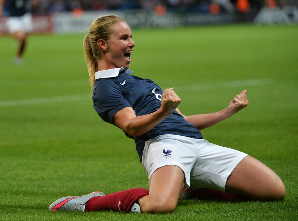 France's midfielder Amandine Henry celebrates after scoring during the Women's friendly football match France versus Brazil on September 19, 2015, at the Oceane Stadium in Le Havre, northwestern France. AFP PHOTO/ JEAN-FRANCOIS MONIER