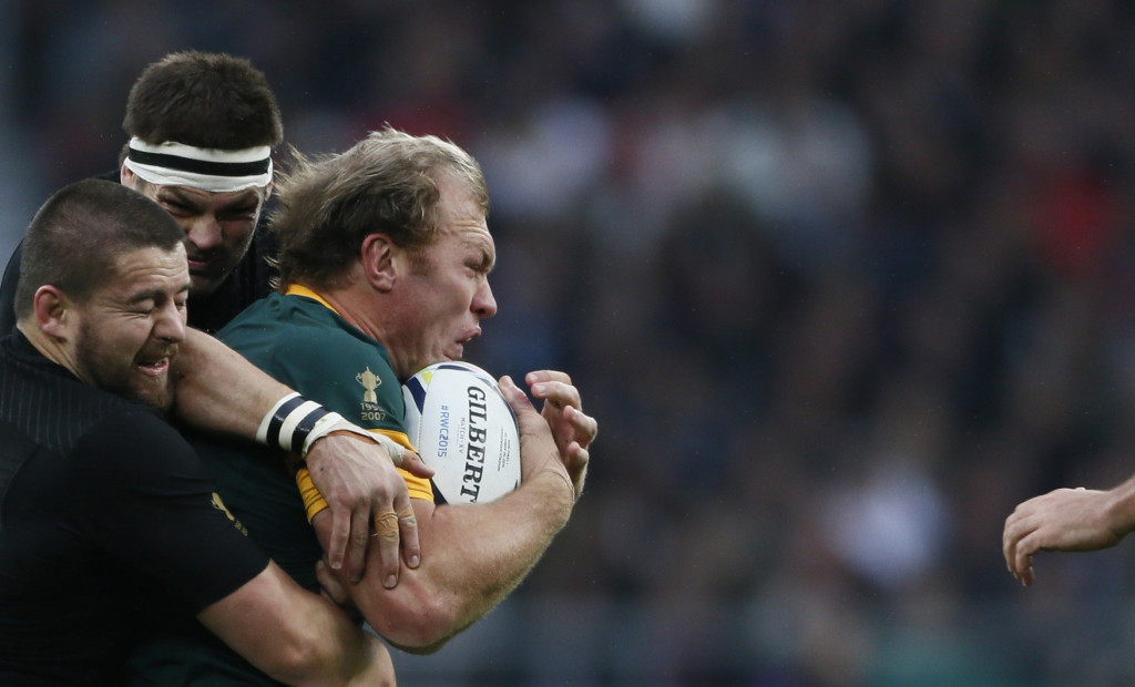 Schalk Burger of South Africa (R) is tacked by Richie McCaw of New Zealand (C) during their Rugby World Cup Semi-Final match at Twickenham in London, Britain, October 24, 2015. REUTERS/Stefan Wermuth TPX IMAGES OF THE DAY - RTX1T1D6