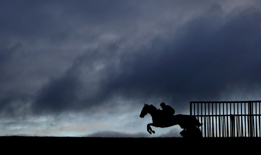 WINCANTON, ENGLAND - NOVEMBER 19: A general view as a runner clears a flight of hurdles on the back straight at Wincanton racecourse on November 19, 2015 in Wincanton, England. (Photo by Alan Crowhurst/Getty Images)