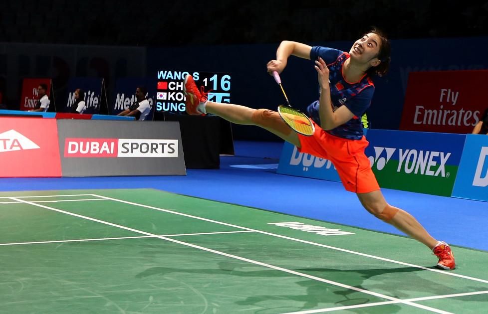 Wang Shixian of China returns a hit to Sung Ji-Hyun of South Korea during the women's singles match during the Dubai World Superseries Finals badminton tournament in Dubai on December 10, 2015. / AFP / MARWAN NAAMANI
