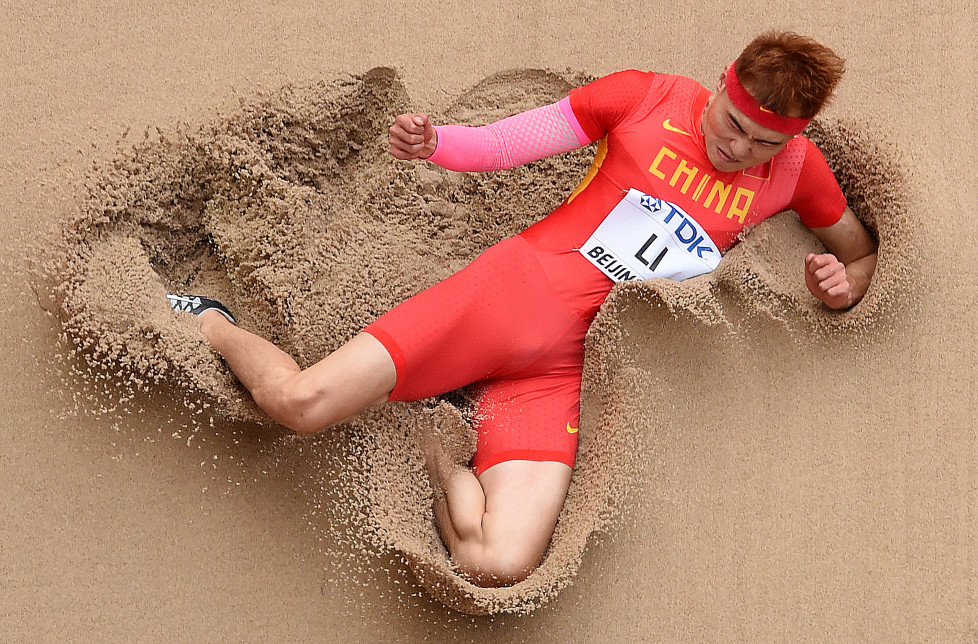 "China's Li Jinzhe competes in the qualifying round of the men's long jump athletics event at the 2015 IAAF World Championships at the ""Bird's Nest"" National Stadium in Beijing on August 24, 2015. AFP PHOTO / ANTONIN THUILLIER / AFP / ANTONIN THUILLIER"