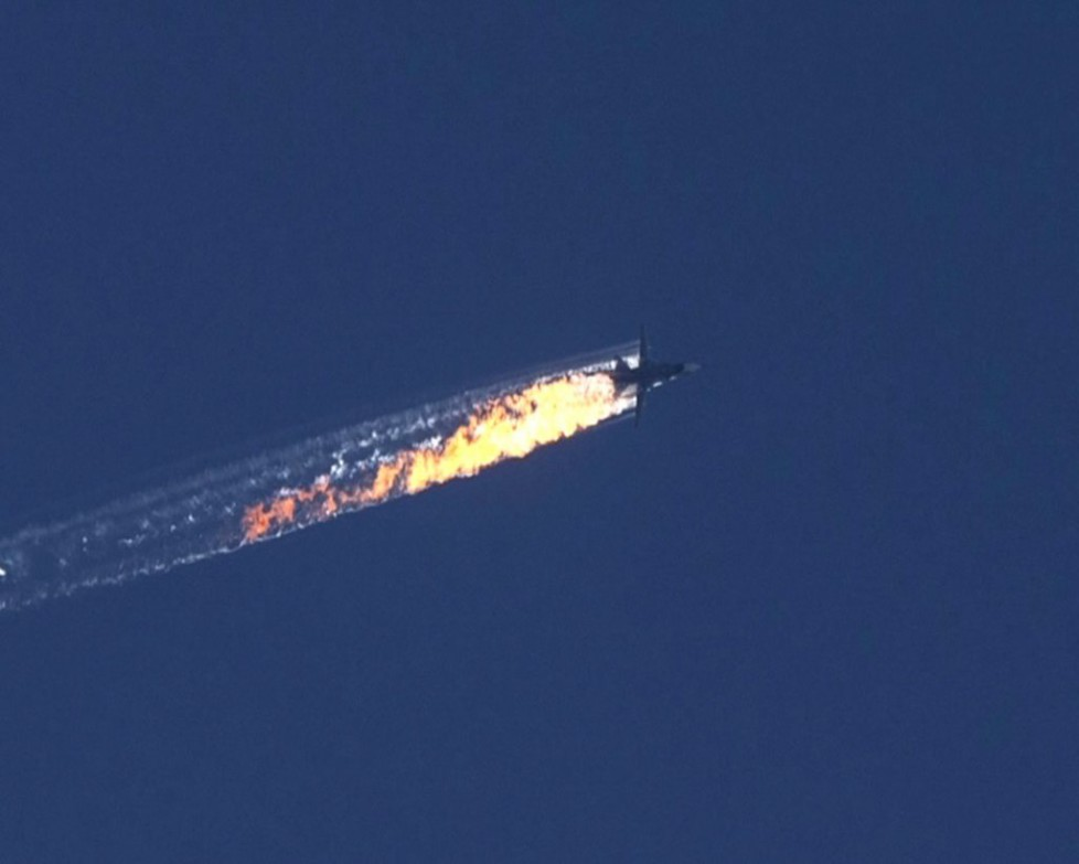 epa05039461 A still image made available on 24 November 2015 from video footage shown by the HaberTurk TV Channel shows a burning trail as a plane comes down after being shot down near the Turkish-Syrian border, over north Syria, 24 November 2015. A Russian fighter jet was shot down 24 November over the Turkish-Syrian border, the Defence Ministry in Moscow said, according to Interfax news agency. The Sukhoi Su-24 was reportedly downed by Turkish forces, Turkish state news agency Anadolu reported, citing sources in the presidency. The report said that the jet violated Turkish airspace and ignored warnings. It crashed in the north-western Syrian town of Bayirbucak, Turkish security sources were quoted as saying. EPA/HABERTURK TV CHANNEL MANDATORY CREDIT: HABERTURK TV CHANNEL