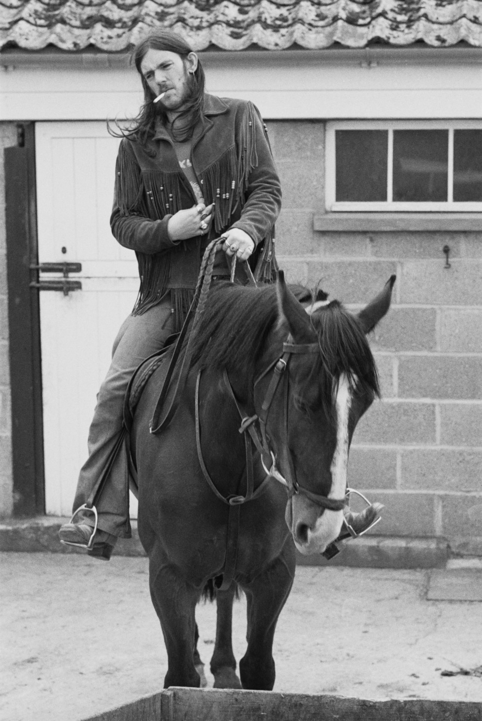 English bassist and singer Ian 'Lemmy' Kilmister, of space rock group Hawkwind, on horseback, 10th May1974. (Photo by Michael Putland/Getty Images)