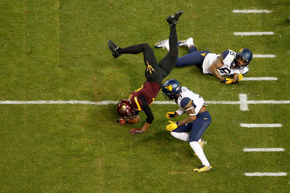 PHOENIX, AZ - JANUARY 02: Running back Gump Hayes #16 of the Arizona State Sun Devils is tackled by cornerback Ricky Rumph #3 and safety Dravon Askew-Henry #6 of the West Virginia Mountaineers during the second quarter of the Motel 6 Cactus Bowl at Chase Field on January 2, 2016 in Phoenix, Arizona. (Photo by Christian Petersen/Getty Images)