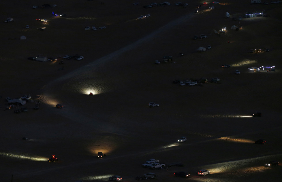 Cars' headlights illuminate the Liwa desert, some 250 kilometres southwest of Abu Dhabi, late on January 7, 2016, during the Liwa 2016 Moreeb Dune Festival. The festival, which attracts participants from around the Gulf region, includes a variety of races (cars, bikes, falcons, camels and horses) or other activities aimed at promoting the country's folklore. AFP PHOTO / KARIM SAHIB / AFP / KARIM SAHIB