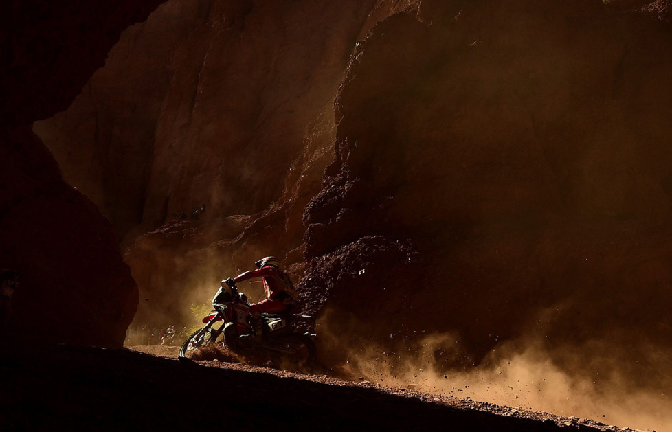 TOPSHOT - Honda's French biker Adrien Metge competes during Stage 8 of the Dakar 2016 between Salta and Belen, Argentina, on January 11, 2016.AFP PHOTO / FRANCK FIFE / AFP / FRANCK FIFE (Photo credit should read FRANCK FIFE/AFP/Getty Images)