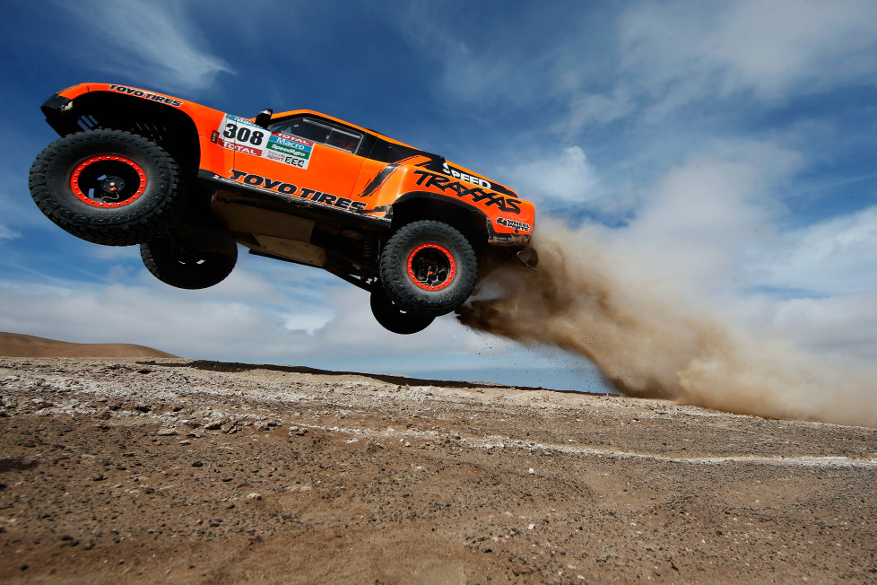 IQUIQUE, CHILE - JANUARY 13: #308 Robby Gordon and Johnny Campbell of the USA driving for Speed Energy Racing HST Hummer launches over a jump in the Atacama Desert during day 10 of the Dakar Rallly between Iquique on Calama January 13, 2015 in Iquique, Chile. (Photo by Dean Mouhtaropoulos/Getty Images)