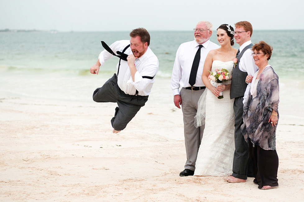 **MANDATORY PICTURE CREDIT** PIC BY: JONATHAN COSSU / ISPWP / CATERS NEWS (Pictured: Man photobombs family photo) - These hilarious photos will leave people WEDDING themselves with laughter. The images - which include photobombs, wardrobe malfunctions and unexpected animal behaviour - have been released by the International Society of Professional Wedding Photographs (ISPWP). Each year the society holds quarterly competitions, celebrating a variety of the best image from couples special days. Other categories in the ISPWPs completions include the likes Getting Ready, First Dance, Family Love, and a selection of portrait possibilities. - SEE CATERS COPY (FOTO: DUKAS/CATERSNEWS) *** Local Caption *** Funniest Wedding Photos of 2015