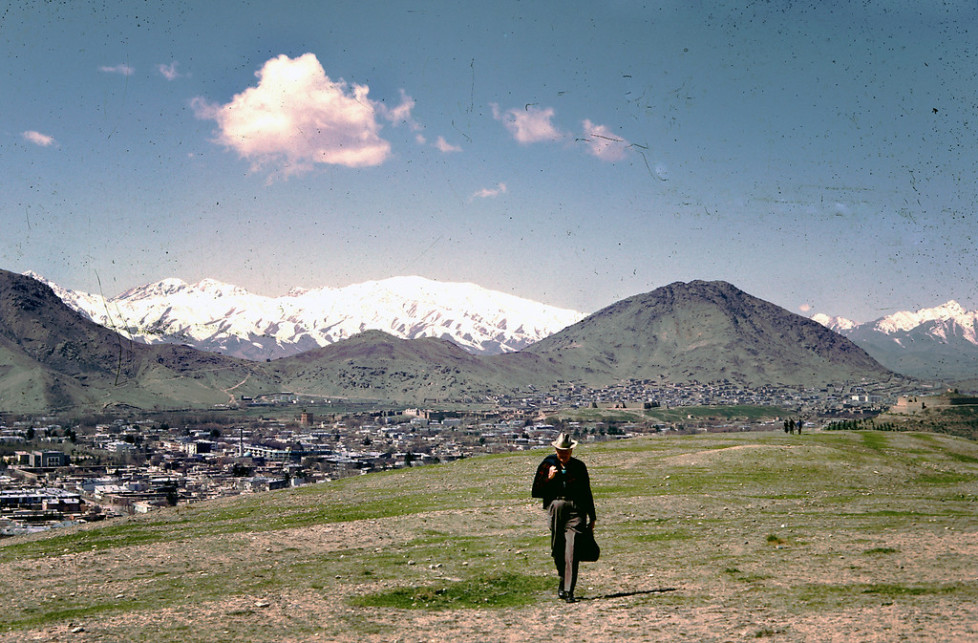 """""""Dr. Bill Podlich on a hillside in Kabul. """"My dad was a professor of Elementary Education, specializing in teaching Social Studies, at Arizona State University in Tempe, Arizona from 1949 until he retired in 1981. He had always said that since he had served in WWII (he trained soldiers against chemical warfare), he wanted to serve in the cause of peace. In 1967, he was hired by UNESCO as an Expert on Principles of Education, for a two-year stint in Kabul, Afghanistan at the Higher TeachersÕ College. Throughout his adult life, because he was interested in social studies, whenever he traveled around (in Arizona, to Mexico and other places), he continued to take pictures. In Afghanistan he took half-frame color slides (on Kodachrome), and I believe he used a small Olympus camera."""" - Peg Podlich."""""""