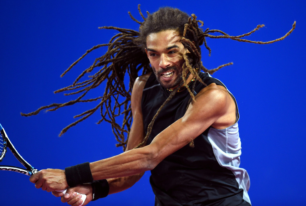 German's player Dustin Brown returns the ball to French's player Gilles Simon during their tennis match at the Open Sud de France ATP World Tour in Montpellier, southern France, on February 4, 2016. / AFP / PASCAL GUYOT