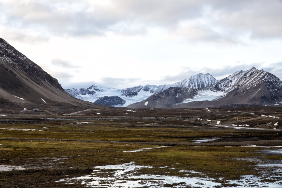 """Snow covers Broggerdalen mountain near Ny-Alesund, Svalbard, Norway October 11, 2015. A Norwegian chain of islands just 1,200 km (750 miles) from the North Pole is trying to promote new technologies, tourism and scientific research in a shift from high-polluting coal mining that has been a backbone of the remote economy for decades. Norway suspended most coal mining on the Svalbard archipelago last year because of the high costs, and is looking for alternative jobs for about 2,200 inhabitants on islands where polar bears roam. Part of the answer may be to boost science: in Ny-Alesund, the world's most northerly permanent non-military settlement, scientists from 11 nations including Norway, Germany, France, Britain, India and South Korea study issues such as climate change. The presence of Norway, a NATO member, also gives the alliance a strategic foothold in the far north, of increasing importance after neighbouring Russia annexed Ukraine's Crimea region in 2014. REUTERS/Anna FilipovaPICTURE 18 OF 19 - SEARCH """"SVALBARD FILIPOVA"""" FOR ALL IMAGES"""