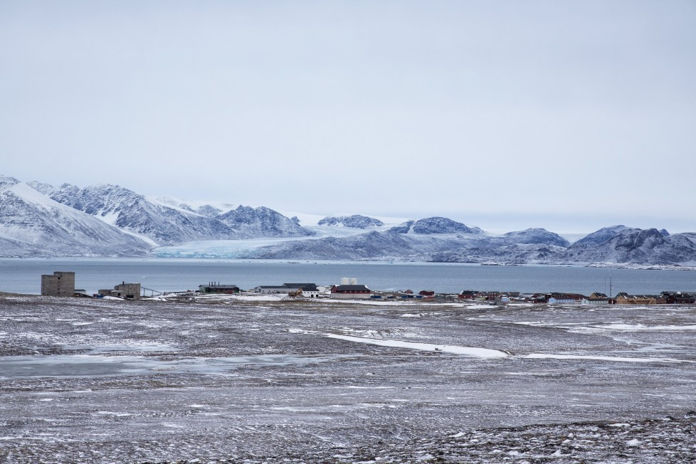 """An overview of the residential and research settlement areas for scientists at the Kings Bay in Ny-Alesund, Svalbard, Norway, October 15, 2015. A Norwegian chain of islands just 1,200 km (750 miles) from the North Pole is trying to promote new technologies, tourism and scientific research in a shift from high-polluting coal mining that has been a backbone of the remote economy for decades. Norway suspended most coal mining on the Svalbard archipelago last year because of the high costs, and is looking for alternative jobs for about 2,200 inhabitants on islands where polar bears roam. Part of the answer may be to boost science: in Ny-Alesund, the world's most northerly permanent non-military settlement, scientists from 11 nations including Norway, Germany, France, Britain, India and South Korea study issues such as climate change. The presence of Norway, a NATO member, also gives the alliance a strategic foothold in the far north, of increasing importance after neighbouring Russia annexed Ukraine's Crimea region in 2014. REUTERS/Anna FilipovaPICTURE 17 OF 19 - SEARCH """"SVALBARD FILIPOVA"""" FOR ALL IMAGES"""