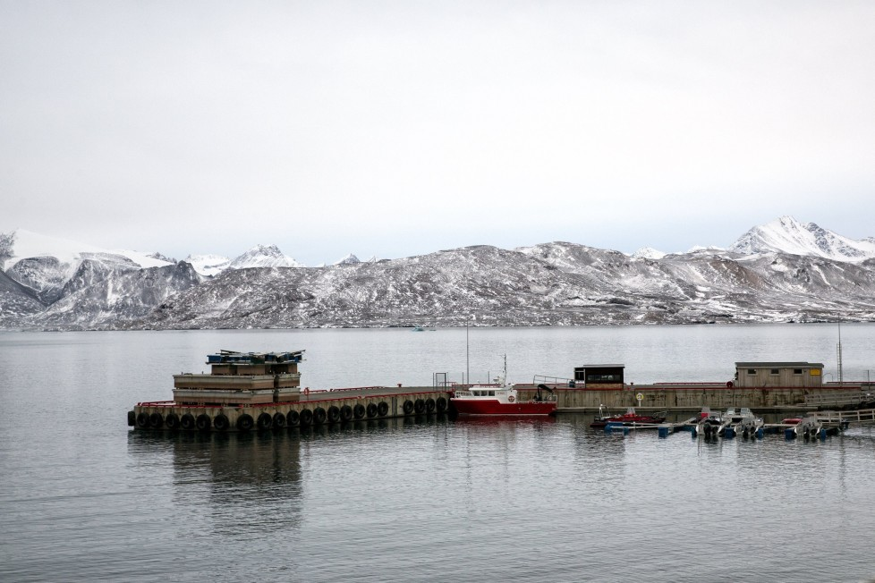 """Dinghies and research vessels are pictured in the small harbour near Ny-Alesund on Spitsbergen, Norway October 15, 2015. A Norwegian chain of islands just 1,200 km (750 miles) from the North Pole is trying to promote new technologies, tourism and scientific research in a shift from high-polluting coal mining that has been a backbone of the remote economy for decades. Norway suspended most coal mining on the Svalbard archipelago last year because of the high costs, and is looking for alternative jobs for about 2,200 inhabitants on islands where polar bears roam. Part of the answer may be to boost science: in Ny-Alesund, the world's most northerly permanent non-military settlement, scientists from 11 nations including Norway, Germany, France, Britain, India and South Korea study issues such as climate change. The presence of Norway, a NATO member, also gives the alliance a strategic foothold in the far north, of increasing importance after neighbouring Russia annexed Ukraine's Crimea region in 2014. REUTERS/Anna FilipovaPICTURE 16 OF 19 - SEARCH """"SVALBARD FILIPOVA"""" FOR ALL IMAGES"""
