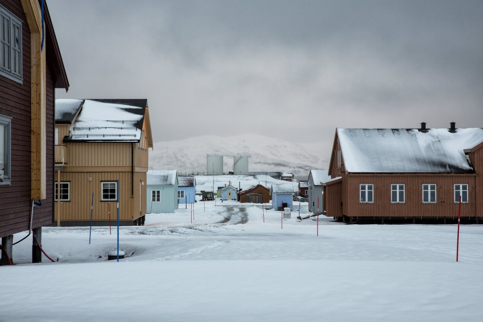 """Snow is seen on the Ny-Alesund research centre, that was formerly a coal mining town October 19, 2015. A Norwegian chain of islands just 1,200 km (750 miles) from the North Pole is trying to promote new technologies, tourism and scientific research in a shift from high-polluting coal mining that has been a backbone of the remote economy for decades. Norway suspended most coal mining on the Svalbard archipelago last year because of the high costs, and is looking for alternative jobs for about 2,200 inhabitants on islands where polar bears roam. Part of the answer may be to boost science: in Ny-Alesund, the world's most northerly permanent non-military settlement, scientists from 11 nations including Norway, Germany, France, Britain, India and South Korea study issues such as climate change. The presence of Norway, a NATO member, also gives the alliance a strategic foothold in the far north, of increasing importance after neighbouring Russia annexed Ukraine's Crimea region in 2014. REUTERS/Anna FilipovaPICTURE 08 OF 19 - SEARCH """"SVALBARD FILIPOVA"""" FOR ALL IMAGES"""