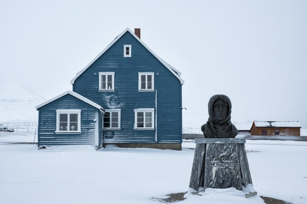 """A scupted bust of Norwegian explorer Roald Amundsen is seen at the scientific base of Ny Alesund, in Norway, October 18, 2015. A Norwegian chain of islands just 1,200 km (750 miles) from the North Pole is trying to promote new technologies, tourism and scientific research in a shift from high-polluting coal mining that has been a backbone of the remote economy for decades. Norway suspended most coal mining on the Svalbard archipelago last year because of the high costs, and is looking for alternative jobs for about 2,200 inhabitants on islands where polar bears roam. Part of the answer may be to boost science: in Ny-Alesund, the world's most northerly permanent non-military settlement, scientists from 11 nations including Norway, Germany, France, Britain, India and South Korea study issues such as climate change. The presence of Norway, a NATO member, also gives the alliance a strategic foothold in the far north, of increasing importance after neighbouring Russia annexed Ukraine's Crimea region in 2014. REUTERS/Anna FilipovaPICTURE 09 OF 19 - SEARCH """"SVALBARD FILIPOVA"""" FOR ALL IMAGES"""