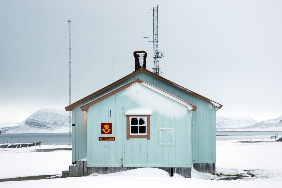 """The northernmost non-military post office in the world in the Kings Bay research station in Ny-Alesund, Svalbard, Norway, October 18, 2015. A Norwegian chain of islands just 1,200 km (750 miles) from the North Pole is trying to promote new technologies, tourism and scientific research in a shift from high-polluting coal mining that has been a backbone of the remote economy for decades. Norway suspended most coal mining on the Svalbard archipelago last year because of the high costs, and is looking for alternative jobs for about 2,200 inhabitants on islands where polar bears roam. Part of the answer may be to boost science: in Ny-Alesund, the world's most northerly permanent non-military settlement, scientists from 11 nations including Norway, Germany, France, Britain, India and South Korea study issues such as climate change. The presence of Norway, a NATO member, also gives the alliance a strategic foothold in the far north, of increasing importance after neighbouring Russia annexed Ukraine's Crimea region in 2014. REUTERS/Anna FilipovaPICTURE 10 OF 19 - SEARCH """"SVALBARD FILIPOVA"""" FOR ALL IMAGES"""