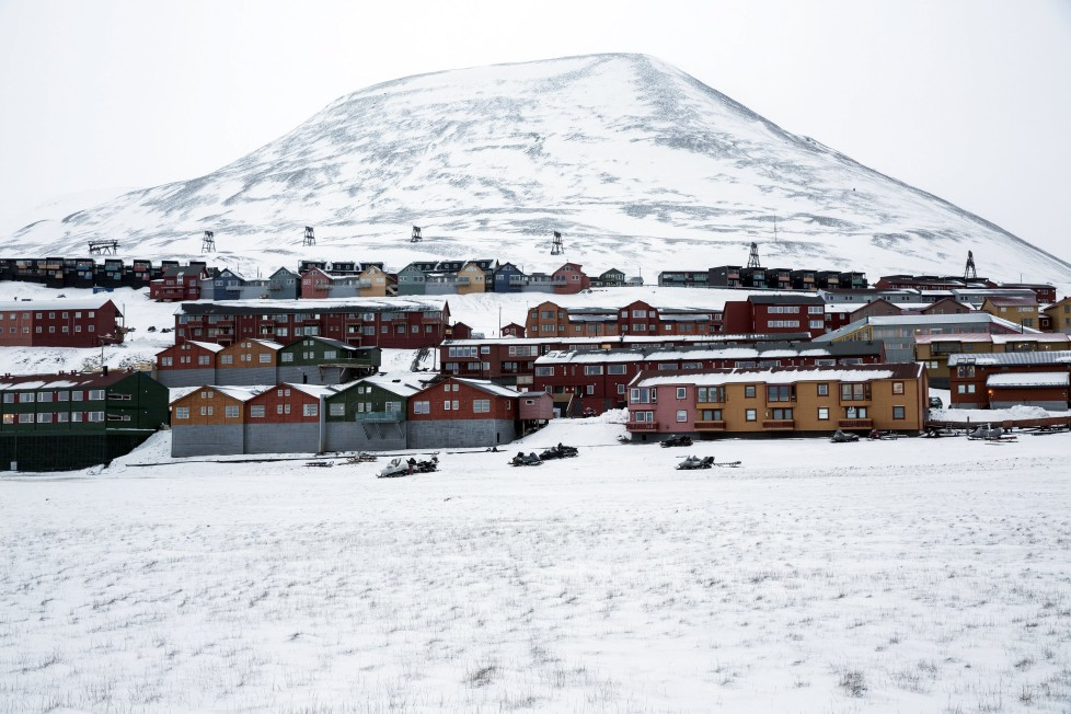 """Workers housing of Longyerbyean, Svalbard are seen covered in snow October 23, 2015. A Norwegian chain of islands just 1,200 km (750 miles) from the North Pole is trying to promote new technologies, tourism and scientific research in a shift from high-polluting coal mining that has been a backbone of the remote economy for decades. Norway suspended most coal mining on the Svalbard archipelago last year because of the high costs, and is looking for alternative jobs for about 2,200 inhabitants on islands where polar bears roam. Part of the answer may be to boost science: in Ny-Alesund, the world's most northerly permanent non-military settlement, scientists from 11 nations including Norway, Germany, France, Britain, India and South Korea study issues such as climate change. The presence of Norway, a NATO member, also gives the alliance a strategic foothold in the far north, of increasing importance after neighbouring Russia annexed Ukraine's Crimea region in 2014. REUTERS/Anna Filipova TPX IMAGES OF THE DAYPICTURE 05 OF 19 - SEARCH """"SVALBARD FILIPOVA"""" FOR ALL IMAGES"""