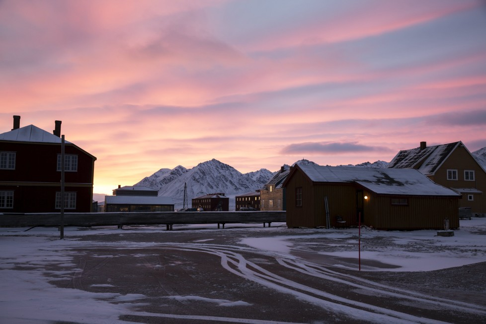 """Dawn at the scientific base of Ny-Alesund, Svalbard, Norway October 14, 2015. A Norwegian chain of islands just 1,200 km (750 miles) from the North Pole is trying to promote new technologies, tourism and scientific research in a shift from high-polluting coal mining that has been a backbone of the remote economy for decades. Norway suspended most coal mining on the Svalbard archipelago last year because of the high costs, and is looking for alternative jobs for about 2,200 inhabitants on islands where polar bears roam. Part of the answer may be to boost science: in Ny-Alesund, the world's most northerly permanent non-military settlement, scientists from 11 nations including Norway, Germany, France, Britain, India and South Korea study issues such as climate change. The presence of Norway, a NATO member, also gives the alliance a strategic foothold in the far north, of increasing importance after neighbouring Russia annexed Ukraine's Crimea region in 2014. REUTERS/Anna FilipovaPICTURE 03 OF 19 - SEARCH """"SVALBARD FILIPOVA"""" FOR ALL IMAGES"""