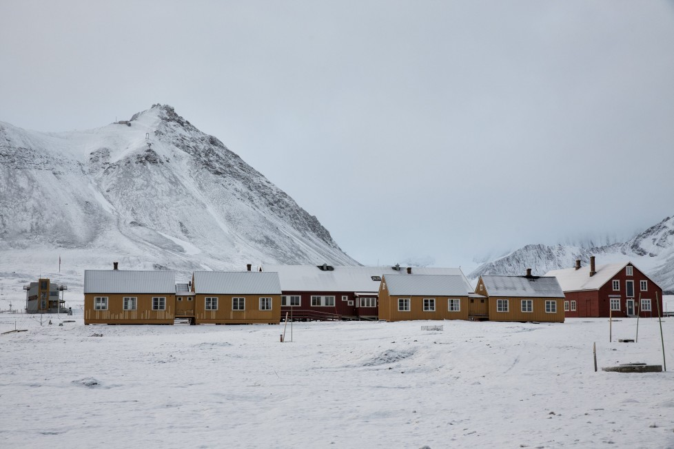"""Snow is seen on the research centre, formerly a coal mining town, in Ny-Alesund, Svalbard, Norway October 13, 2015. A Norwegian chain of islands just 1,200 km (750 miles) from the North Pole is trying to promote new technologies, tourism and scientific research in a shift from high-polluting coal mining that has been a backbone of the remote economy for decades. Norway suspended most coal mining on the Svalbard archipelago last year because of the high costs, and is looking for alternative jobs for about 2,200 inhabitants on islands where polar bears roam. Part of the answer may be to boost science: in Ny-Alesund, the world's most northerly permanent non-military settlement, scientists from 11 nations including Norway, Germany, France, Britain, India and South Korea study issues such as climate change. The presence of Norway, a NATO member, also gives the alliance a strategic foothold in the far north, of increasing importance after neighbouring Russia annexed Ukraine's Crimea region in 2014. REUTERS/Anna FilipovaPICTURE 04 OF 19 - SEARCH """"SVALBARD FILIPOVA"""" FOR ALL IMAGES"""