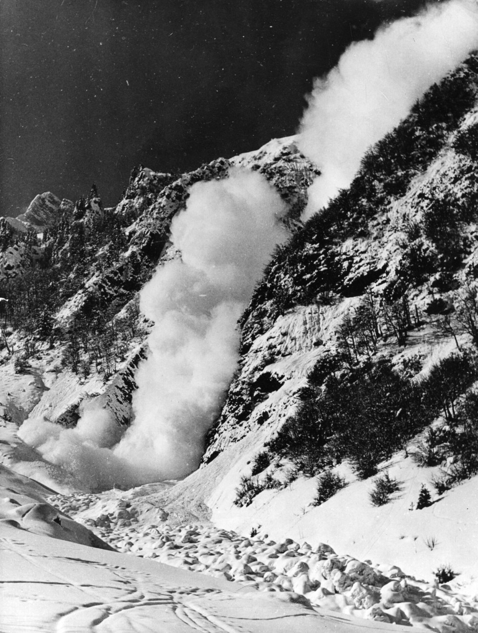 25th March 1958: A small avalanche in Switzerland. (Photo by Keystone/Getty Images)