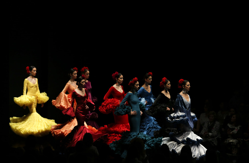 Models present creations by Alejandro Santizo during the International Flamenco Fashion Show SIMOF in the Andalusian capital of Seville, Spain, February 5, 2016. REUTERS/Marcelo del Pozo - RTX25LE2