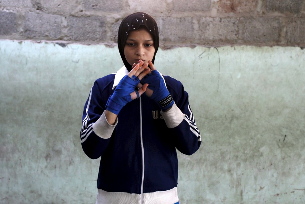 """Azmeena, 16, takes part in warm up exercises at the first women's boxing coaching camp in Karachi, Pakistan February 19, 2016. For the past six months about a dozen girls, aged 8 to 17, have gone to the Pak Shine Boxing Club after school to practice their jabs, hooks and upper cuts. Pakistani women have been training as boxers in small numbers and competed in the South Asian Games last year, said Younis Qambrani, the coach who founded the club in 1992 in the Karachi neighbourhood of Lyari, better known for internecine gang warfare than for breaking glass ceilings. REUTERS/Akhtar Soomro SEARCH """"THE WIDER IMAGE"""" FOR ALL STORIES"""