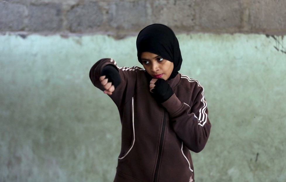 """REFILE - CLARIFYING NAME OF BOXING CLUBMisbah, 17, takes part in warm up exercises at the first women's boxing coaching camp in Karachi, Pakistan February 19, 2016. For the past six months about a dozen girls, aged 8 to 17, have gone to the Pak Shaheen Boxing Club after school to practice their jabs, hooks and upper cuts. Pakistani women have been training as boxers in small numbers and competed in the South Asian Games last year, said Younis Qambrani, the coach who founded the club in 1992 in the Karachi neighbourhood of Lyari, better known for internecine gang warfare than for breaking glass ceilings. REUTERS/Akhtar Soomro SEARCH """"THE WIDER IMAGE"""" FOR ALL STORIES"""