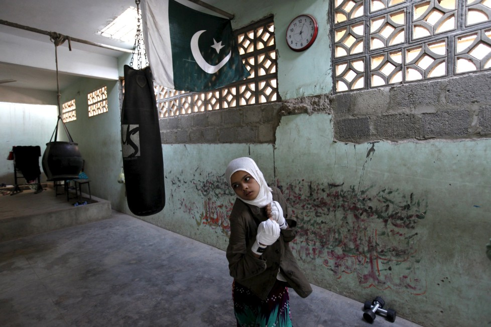 """REFILE - CLARIFYING NAME OF BOXING CLUBMehek, 15, who has her hands wrapped, takes part in an exercise session at the first women's boxing coaching camp in Karachi, Pakistan February 19, 2016. For the past six months about a dozen girls, aged 8 to 17, have gone to the Pak Shaheen Boxing Club after school to practice their jabs, hooks and upper cuts. Pakistani women have been training as boxers in small numbers and competed in the South Asian Games last year, said Younis Qambrani, the coach who founded the club in 1992 in the Karachi neighbourhood of Lyari, better known for internecine gang warfare than for breaking glass ceilings. REUTERS/Akhtar Soomro SEARCH """"THE WIDER IMAGE"""" FOR ALL STORIES TPX IMAGES OF THE DAY"""