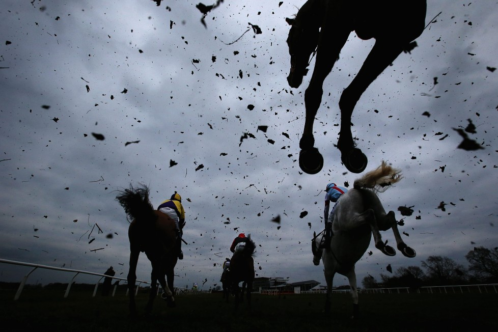 WETHERBY, ENGLAND - MARCH 22: Horses clear a fence during the Racing UK Profits Returned To Racing Handicap Steeple Chase at Wetherby Racecourse on March 22, 2016 in Wetherby, England. (Photo by Alex Livesey/Getty Images) *** BESTPIX ***