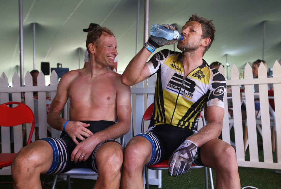 epa05217989 Swiss rider Urs Huber (L) and Germany's Karl Platt (R) of Team Bulls rest after the 95km Stage 5 of the 2016 ABSA Cape Epic mountain bike race near Boschendal, South Africa, 18 March 2016. The ABSA Cape Epic is often described as the 'Tour de France' of mountain biking and will see 1,200 riders racing over 652km in eight stages and 15,100m of climbing. UCI professional racers ride alongside amateur riders during the eight day long race. EPA/KIM LUDBROOK