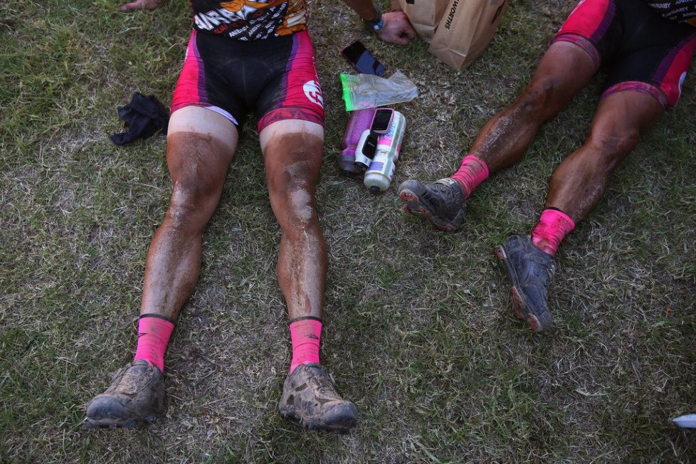 epa05211481 Riders with dust lines on their legs rest after completing the 108km Stage 1 of the 2016 ABSA Cape Epic mountain bike race in Saronsberg South Africa, 14 March 2016. Scores of riders where eliminated from the race after missing the cut off time for the stage. The ABSA Cape Epic is often described as the 'Tour de France' of mountain biking and will see 1,200 riders racing over 652km in eight stages and 15,100m of climbing. UCI professional racers ride alongside amateur riders during the eight day long race. EPA/KIM LUDBROOK
