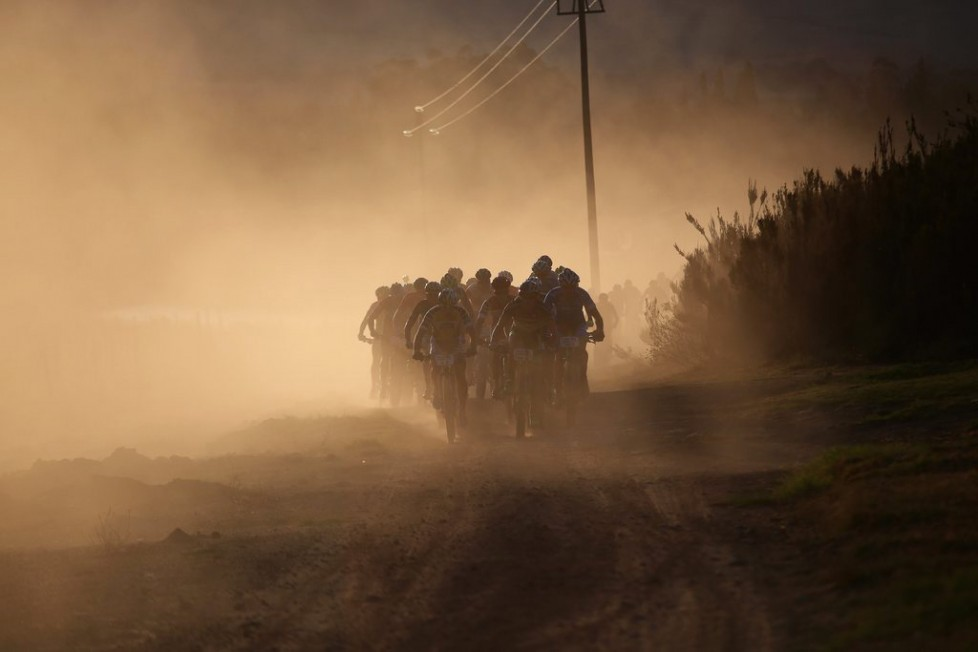 epa05210794 The peleton ride in the morning sun in the early part of the 108km Stage 1 of the 2016 ABSA Cape Epic mountain bike race in Saronsberg South Africa, 14 March 2016. The ABSA Cape Epic is often described as the 'Tour de France' of mountain biking and will see 1,200 riders racing over 652km in eight stages and 15,100m of climbing. UCI professional racers ride alongside amateur riders during the eight day long race. EPA/KIM LUDBROOK