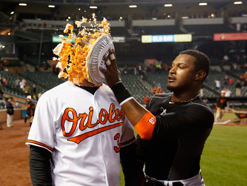 BALTIMORE, MARYLAND - APRIL 04: Adam Jones #10 (R) hits Matt Wieters #32 of the Baltimore Orioles in the face with pie after the Orioles defeated the Minnesota Twins 3-2 during their Opening Day game Oriole Park at Camden Yards on April 4, 2016 in Baltimore, Maryland. (Photo by Rob Carr/Getty Images)