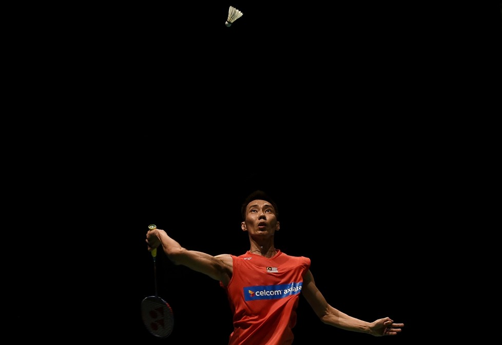 Malaysia's Lee Chong Wei eyes a return against Son Wan Ho of South Korea during their men's singles round match of the 2016 Malaysia Open Badminton Superseries at the Malawati stadium in Shah Alam on April 7, 2017. / AFP PHOTO / MANAN VATSYAYANA