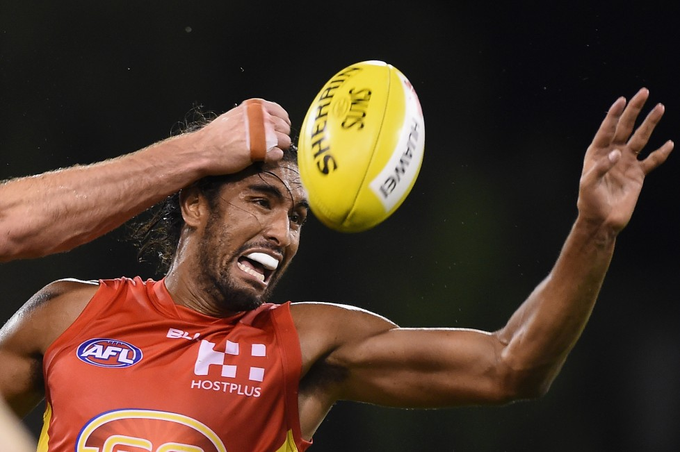 GOLD COAST, QUEENSLAND - APRIL 09: Tom Nicholls of the Suns competes for the ball during the round three AFL match between the Gold Coast Suns and the Carlton Blues at Metricon Stadium on April 9, 2016 on the Gold Coast, Australia. (Photo by Matt Roberts/AFL Media/Getty Images)