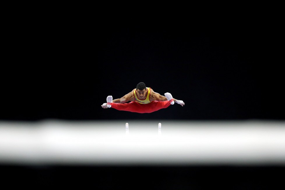 EVERETT, WA - APRIL 10: Javier Sandoval of Columbia competes on the parallel bars during Day 3 of the 2016 Pacific Rim Gymnastics Championships at Xfinity Arena on April 10, 2016 in Everett, Washington. (Photo by Ezra Shaw/Getty Images)