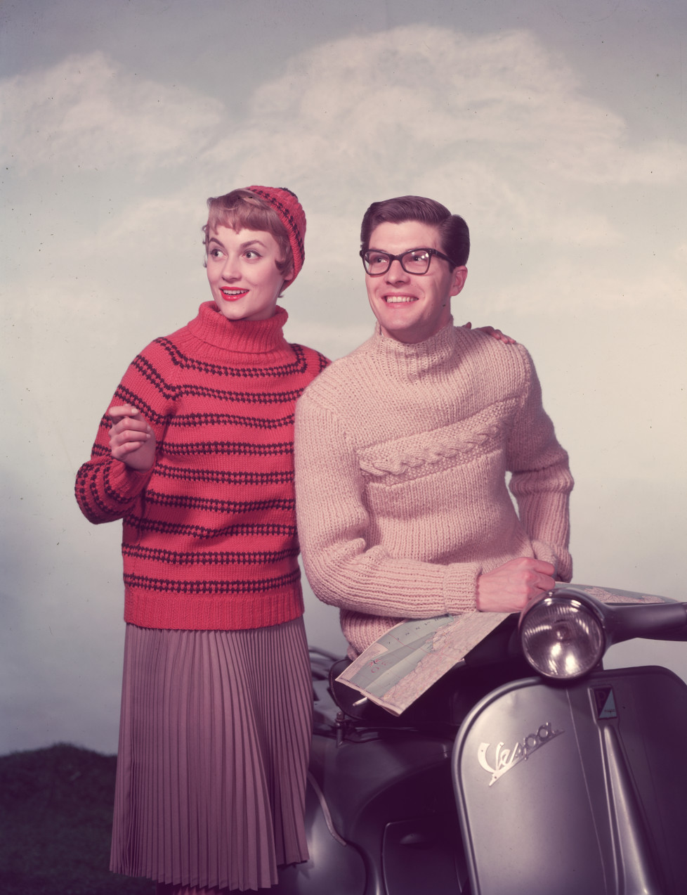 circa 1955: A chic couple with a moped use a map to help plan their route. (Photo by Chaloner Woods/Getty Images)